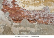 beige-plastered-brickwall-chipped-stucco-260nw-735466384